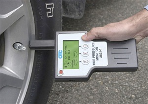 When triggering a sensor, hold the TPMS scan tool directly adjacent to the sensor area.