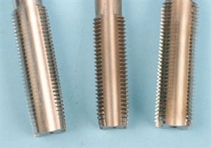 Pictured from the left: a tapered chamfer tap, a plug chamfer tap and a bottoming tap.