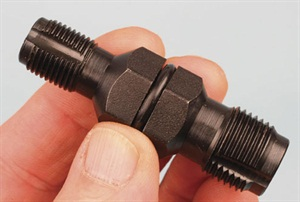 Spark plug hole chasers can save the day when dealing with a slightly damaged spark plug female thread in a cylinder head. This double-ended chaser from Lisle (P/N 20200) features both a 14 mm and an 18 mm spark plug thread chaser. A standard 13/16-inch deepwell spark plug socket wrench is required for driving this chaser. Note the three flutes on each end, which aid in evacuating any debris. This also eases the force required to follow the threads. A center O-ring secures the tool inside the socket wrench.