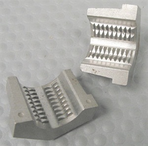 The split die is placed onto the base of the stud, with the flat hex end seated against the hub face. A socket wrench captures the halves together. The die is then rotated outward toward the stud tip.