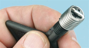 Thread inserts require the use of a special driver tool. Various designs are available depending on the brand. The insert threads onto the driver and is engaged at the insert's bottom tang. The tang exists strictly for installation purposes, and is removed once the insert has been fully installed.