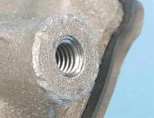 A helically wound thread insert must be installed slightly below the top surface. If the upper end of the wound insert is too close or above the surface, the upper end of the winding may pop out, which creates a host of problems including poor retention, preventing bolt entry and obstruction.