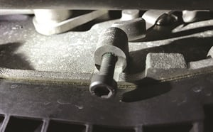 With the BMW transmission plate removed, you'll find a 6 mm x 1.0 bolt on the left side.