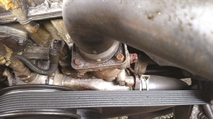 The Ford stamped steel thermostat housing is very prone to rusting, and the thin base distorts when tightened, so it should not be re-used.