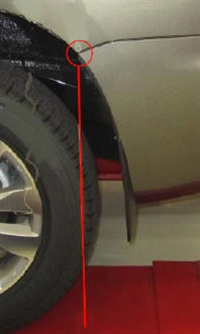 Note the specific height measurement from the tire contact at the rack to the point at which the bumper meets the body.