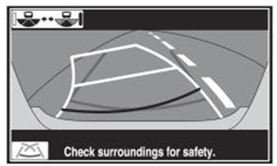 """Figure 2: After placing the transmission in P and turning the steering wheel lock to lock; and then shifting to R, touch the parallel parking mode switch on the screen. Guidelines and the message """"Check surroundings for safety"""" should appear."""