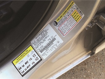 Reprogramming a TPMS to accept a change in tire pressure must include a new modified placard indicating the supplemental tire cold inflation pressure. In this example, the original placard indicates that the vehicle was originally equipped with 225/50R17 tires with a factory-recommended inflation pressure of 31 psi. The modification placard shows a change to 305/35R24 tires, with an inflation pressure of 41 psi.