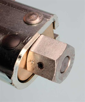 The hex drive head accepts a 27 mm or 1-1/16-inch socket and can be driven manually or with a pneumatic wrench. A six-point impact grade socket is recommended.