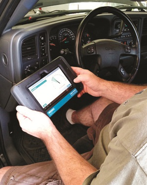 Wireless connectivity of the display tablet allows the technician to perform tests anywhere within a recommended maximum distance of 10 yards. Here a technician raises the vehicle's engine speed while monitoring the screen's tachometer, following the screen's step-by-step prompts.