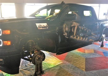 This branded truck with Monroe Magnum strut assemblies will travel the country at company events as Tenneco spreads the work about its newest Monroe products.