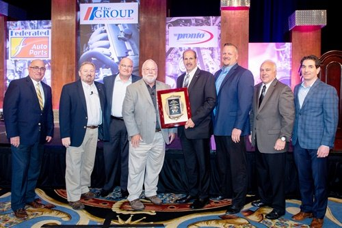 Federated CEO Rusty Bishop (second from left) and Pronto CEO Bill Maggs (fourth from left) present SMP executives with the Outstanding Vendor of the Year award during the Automotive Parts Services Group meeting. (L to R): Paul Farwick, Bishop, Dale Burks, Maggs, Bill Collins, Ryan Kooiman, Ken Wendling and Eric Sills.
