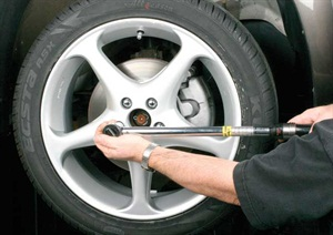 Although it's often tough to convince some auto service shops, the use of a calibrated torque wrench is the only proper way to tighten wheel fasteners. Granted, it's more time consuming, but this eliminates the risk of uneven tightening, which could induce warpage into the rotor. Always tighten any wheel fastener group in a criss-cross manner to evenly spread the clamping load.