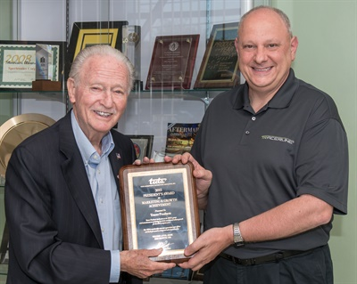 Accepting the award are Tracer Products' Gary Testa (right), with Spectronics' founder and chairman Bill Cooper. In 1955, Cooper invented fluorescent leak detection for the automotive industry.