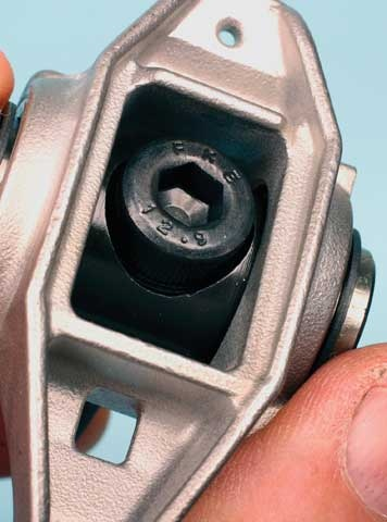 Instead of using the OEM hex head rocker mounting bolts, Comp provides a full set of socket head cap screws. The upgraded cap screw head registers into the trunnion bolt-hole's recess. Apply a bit of assembly lube under the screw head before installation, and torque to Comp's recommendation of 22 ft.-lbs.
