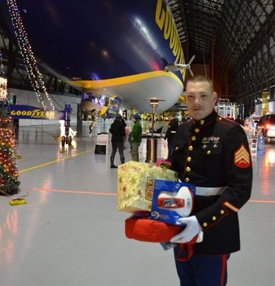 U.S. Marine Sgt. Richard Radtke participated in the 2014 Toys for Tots drive at the Goodyear blimp base in Suffield, Ohio. Goodyear's three U.S. blimp bases are gearing up for their fifth annual effort to benefit the Toys for Tots Foundation in 2015.