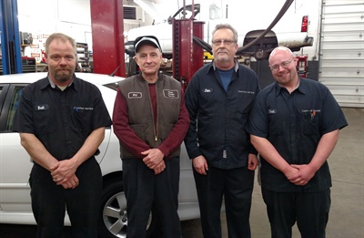 Updated Automotive Repair's topnotch crew (from left to right): Brett Raber, owner Bill Caroniti, John Busler and Brad Horvath. Not pictured is technician Pat Cummings.