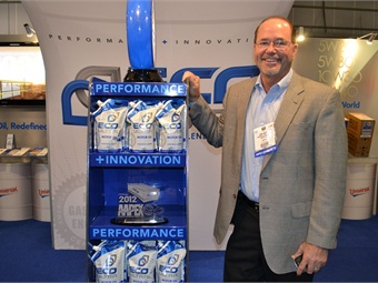 Universal Lubricants' CEO John Wesley, seen here with the ECO ULTRA Flexpak and the award it won, says the product offers consumers an environmentally friendlier choice for oil changes.
