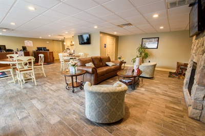 The customer reception/waiting area is decorated with taste and is as nice as, or nicer, than most homes. Owner Frank Palange performed all of the remodeling work.