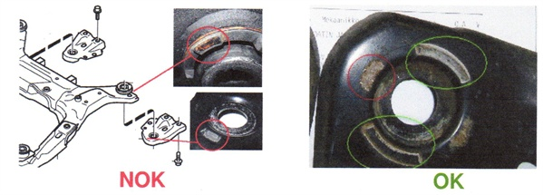 Inspect the subframe rear bushings for wear (contact between the bushing  and the support plate). Isolated wear (as shown on the left) is not  normal. An example of normal contact is shown on the right.