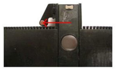 Remove the shifter cover and inspect to verify the position of the small round magnet.