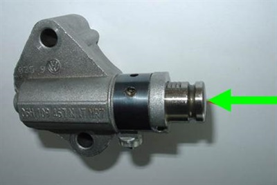 The tensioner plunger should provide pressure against the chain rail.