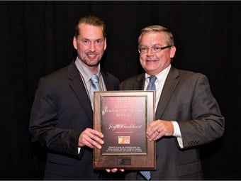 Federal-Mogul's Jay Burkhart (right) is recognized by Federated's Bo Fisher.