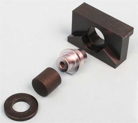 Summit Racing's new trunnion vise tool, P/N SME-906011, allows you to easily and safely remove the original bearings and trunnions and install the upgraded Comp Cams trunnion kit, using a common bench vise instead of a hydraulic press. Removing old trunnions and bearings and installing the new Comp Cams upgrade kit in all 16 rockers can be done in as little as 30 to 45 minutes without breaking a sweat.