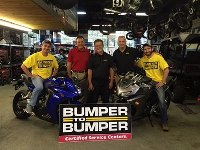 Gary Wyllie, owner of C & G Automotive, gave his sons CJ and Nick motorcycles after becoming a winner in thePerfect Stop Powersports Giveaway. Michael Borr, president of Norwood Motor Parts, and John Tully, sales manager from Norwood Motor Parts, were on hand for the presentation.
