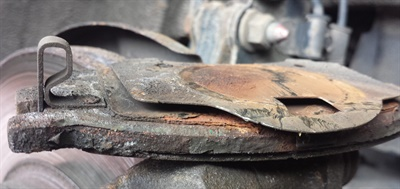 Brake shims should never be reused. Always replace with a small amount of brake lube at the caliper bracket and piston contact points. The corrosion is evident on these examples.