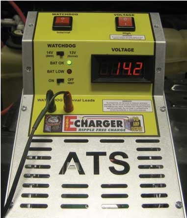 Figure 2. Battery maintainers are absolutely necessary in order to  maintain proper charge. Some are very easy to use. The ATS ECharger  pictured here can charge 14V and 90A simultaneously, presently exceeding  all industry standards for reflashing by about 20 amps.