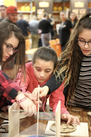 """Three Estrella Middle School (Phoenix) students, who may represent the next generation of techs, demonstrate their planetary gear set project at the recent TechForce Foundation/Arizona Science Center """"Transportation Challenge."""""""