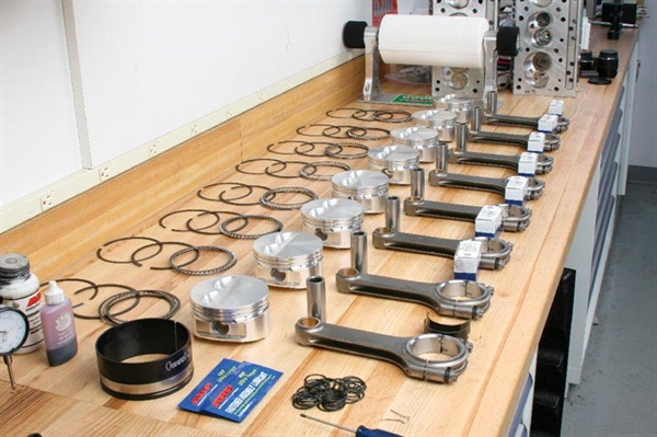 A spacious and clean workbench area provides a sense of order, especially when preparing for engine (or other system) assembly.