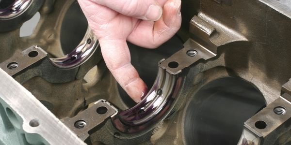 Before installing the crankshaft, be sure to apply assembly lubricant to the front and rear...