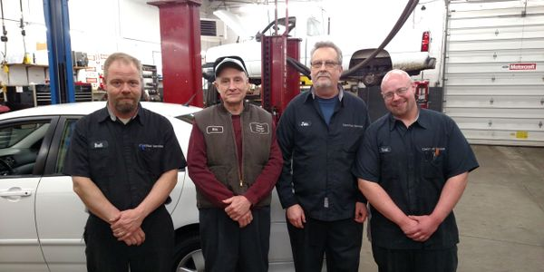 Updated Automotive Repair's topnotch crew (from left to right): Brett Raber, owner Bill...