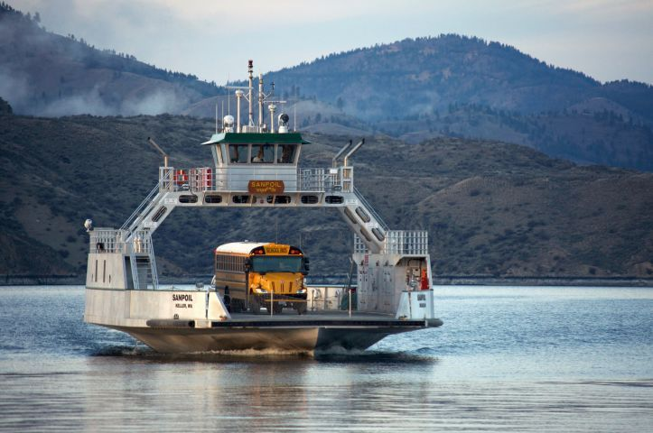 A school bus rides a ferry across Lake Roosevelt in northeastern Washington. The lake, which is...