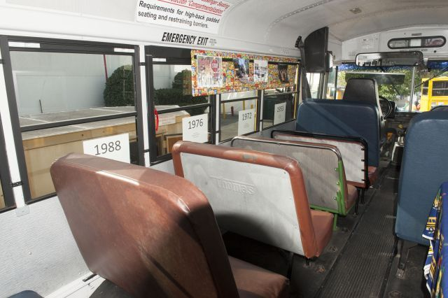 This display on a retired Durham (N.C.) Public Schools bus shows the progression of school bus...
