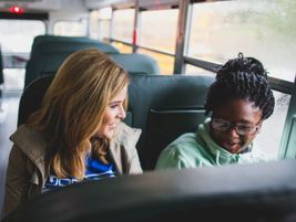 Jenna Bush Hager (left) rides a school bus with students to Lilla G. Frederick Pilot Middle...