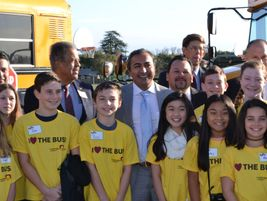 Congressman Bera (center) and other dignitaries posed for photos with students in front of Elk...