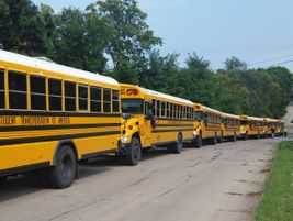 This long lineup of yellow buses is at R.M. Marrs Magnet Center, a middle school in Omaha,...