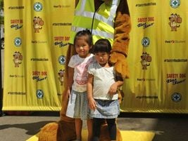 Youngsters pose with Safety Dog, the mascot for First Student. The school bus contractor teamed...