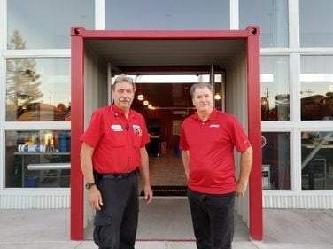 Customers walk through an 8-foot-section of a container to enter the new Tire Pros Super Store...