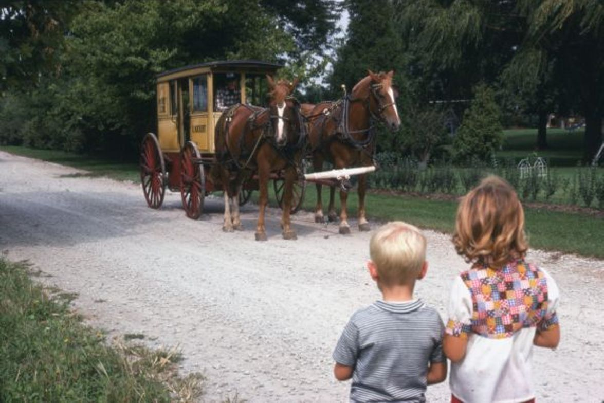 """Kickert School Bus Line's first """"school bus"""" was a horse-drawn wagon fitted with board seats...."""