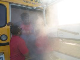 One of the more dramatic hands-on activities was evacuating a school bus on fire.