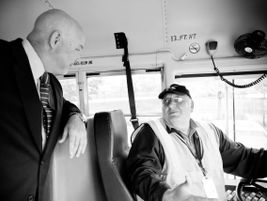 Duke talks with one of the company's school bus drivers. Across all of its operations, National...
