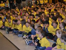 """Cosumnes students in yellow T-shirts screamed in unison, """"We love the bus!"""" Bera had told the..."""