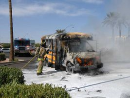 Crews found the Mesa Public Schools bus evacuated, with fire in the front engine compartment.