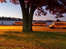 Fog provides an eerie backdrop for buses on an October morning in Highland, Michigan. Valori...