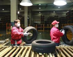 Social distancing must happen in the tire factory, too. ZC Rubber employees are to keep a...