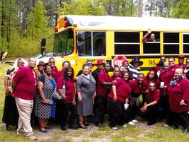 School bus personnel from Atlanta Public Schools pay tribute to one of their colleagues, John...