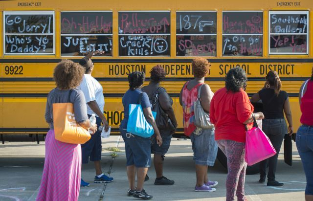 Graffiti was simulated on a school bus as part of a training session on gang awareness at HISD.